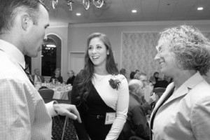 Lowell High School  Athletic Hall of Fame inductee Ashley Nolet, center, talks with LHS assistant  coach Tricia Gabor, right, and one of her track coaches while at  Lowell High,  Peter Molloy, now a Tewksbury High coach. SUN/JULIA MALAKIE